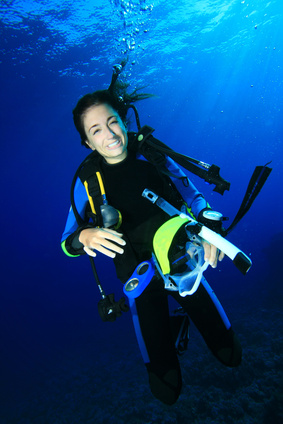 Scuba Diver removes her mask underwater