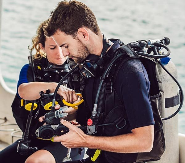 Two SCUBA Buddies Gearing Up