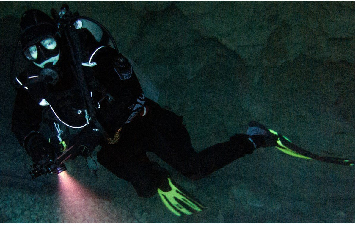 Diving Drysuit diver in cave