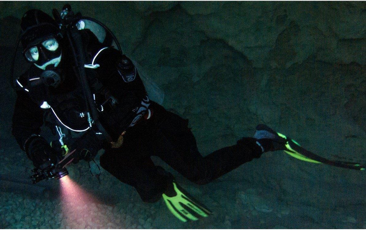 Diving Drysuit diver in cave