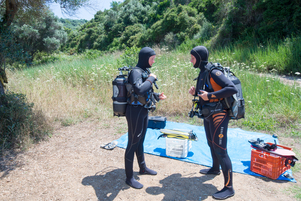 Divers with SCUBA wetsuit hoods